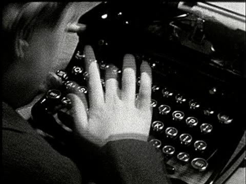 1920s B/W CU, Boy (8-9) using typewriter