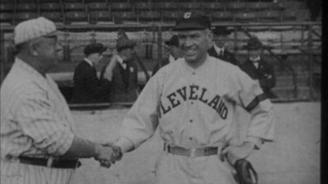 1920s b/w cleveland and yankees manager shaking hands before game / new york city, new york, usa - ニューヨーク・ヤンキース点の映像素材/bロール