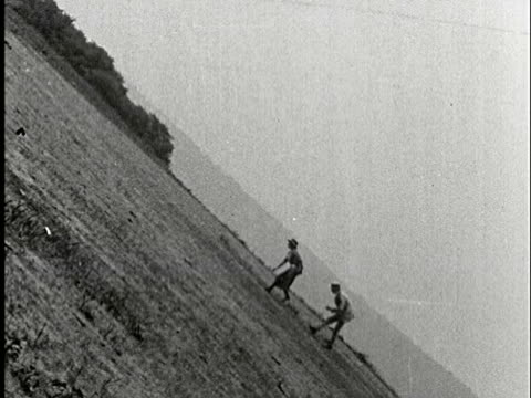 1920s b/w ms, composite, couple walking on field - schrägansicht stock-videos und b-roll-filmmaterial