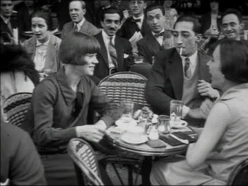 1920s b/w ms man and two women at outdoor cafe laughing and smoking / paris, france - cigarette stock videos & royalty-free footage