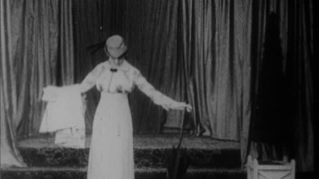 1920s B/W WS Model presenting elegant dress / USA