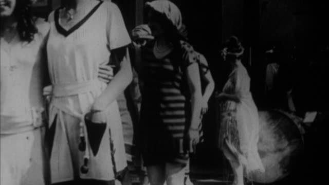 1920s b/w ms models presenting bathing suits / usa - anno 1920 video stock e b–roll