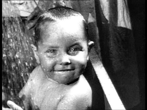 1920s b/w montage babies under shower on chamberpots and eating / russia - ein männliches baby allein stock-videos und b-roll-filmmaterial