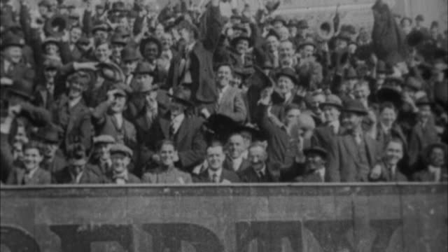 stockvideo's en b-roll-footage met 1920s b/w montage huge crowds attending baseball games / new york city, new york, usa - 1920