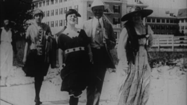 1920s b/w montage people walking along board walk in summer / usa - anno 1920 video stock e b–roll