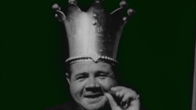 1920s B/W MONTAGE Portrait of Babe Ruth wearing crown and smiling / United States