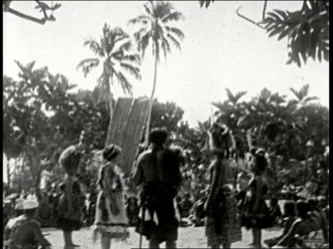 1920s b/w montage samoan wedding bride and groom walk to altar while chiefs sitting on ground watch chief performs ceremony while bride and groom nod... - pazifikinseln stock-videos und b-roll-filmmaterial