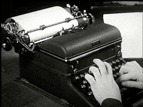 1920s b/w slo mo, cu, ha, person sitting at desk typing on typewriter - skrivmaskin bildbanksvideor och videomaterial från bakom kulisserna