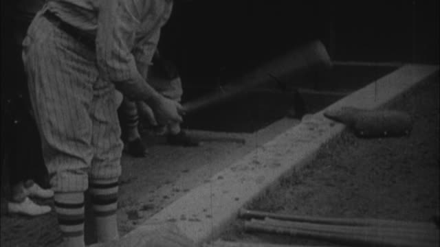 1920s b/w ms tu rogers hornsby picking up bat / united states - only mid adult men stock videos & royalty-free footage