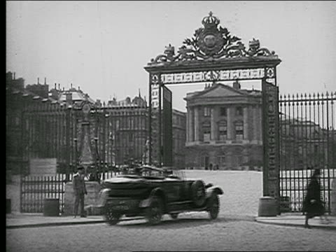 b/w 1920s car driving through ornate iron gates in front of chateau de versailles / france - chateau de versailles stock videos and b-roll footage