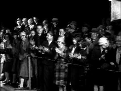 B/W 1920s PAN cheering fans at Graumann's Chinese Theatre for movie premiere at night
