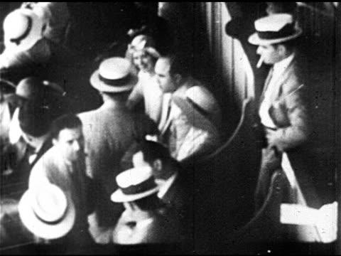 italian-american gangster alphonse gabriel 'al' capone w/ unidentified people at sporting event, possibly race track. 1930 miami mug shot: al capone... - mug shot stock videos & royalty-free footage