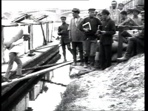 1920s civil war starvation food assistance from western countries foreign aid men unload bags of food from barge at dock load them on truck - civil war stock videos & royalty-free footage