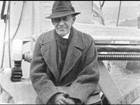 classical musician russian composer pianist conductor sergei rachmaninoff sitting in boat or dock area outside wearing coat hat cu sergei removing... - sergei rachmaninoff stock videos & royalty-free footage