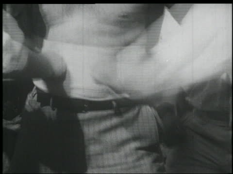 B/W 1920s close up bare-chested man (FA/JR? Richards) getting hit in stomach with fists by 2 men