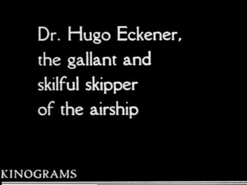 b/w 1920s close up hugo eckener (airship captain) looking down + talking outdoors / slate at beginning - 船長点の映像素材/bロール