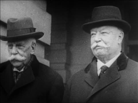 1920s close up justice oliver wendell holmes standing with chief justice william howard taft / newsreel - moustache stock videos & royalty-free footage
