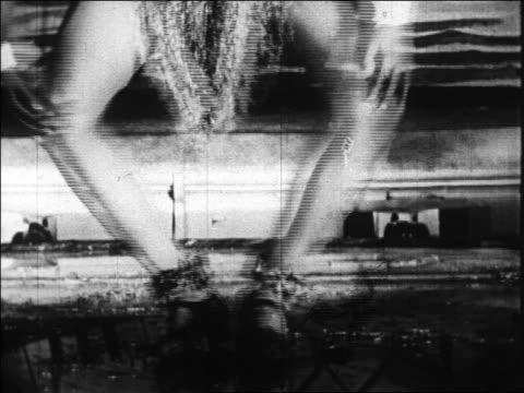 b/w 1920s close up legs of josephine baker doing charleston / folies bergere / paris france / documentary - ventenne video stock e b–roll