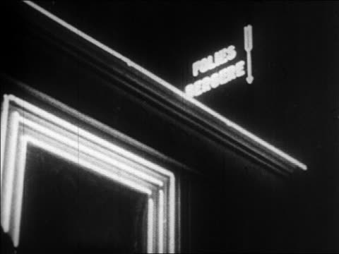 b/w 1920s close up neon sign of folies bergere / tilt down to josephine baker sign / paris, france / documentary - 1920 stock videos & royalty-free footage