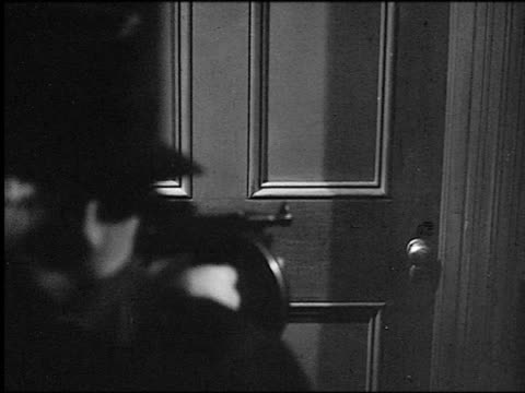 b/w 1920s close up over-the-shoulder man shooting tommy gun at door - machine gun stock videos and b-roll footage