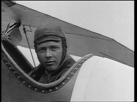 b/w 1920s close up pilot charles lindbergh in hat sitting in cockpit of airplane - charles lindbergh stock videos & royalty-free footage