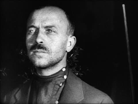 vidéos et rushes de b/w 1920s close up portrait russian man with mustache / russia / documentary - un seul homme d'âge moyen