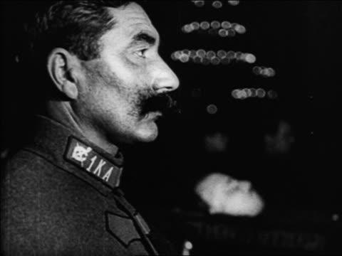 vidéos et rushes de b/w 1920s close up profile russian man with mustache in uniform / russia / documentary - un seul homme d'âge moyen