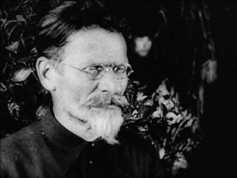 b/w 1920s close up russian man with beard mustache in eyeglasses / russia / documentary - only mature men stock videos & royalty-free footage