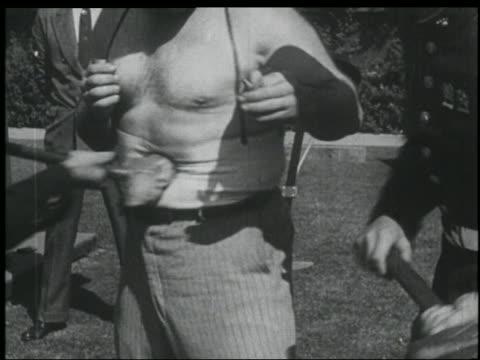 b/w 1920s close up stomach of bare-chested man (fa/jr? richards) getting hit with sledgehammers - sledgehammer stock videos & royalty-free footage