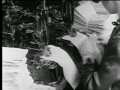 b/w 1920s close up woman sewing buttonholes in cloth on sewing machine in clothing factory / news. - textile stock videos & royalty-free footage