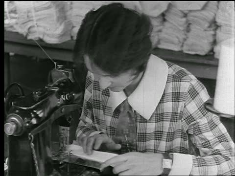 b/w 1920s close up woman sewing collar on sewing machine in clothing factory / newsreel - sewing machine stock videos & royalty-free footage