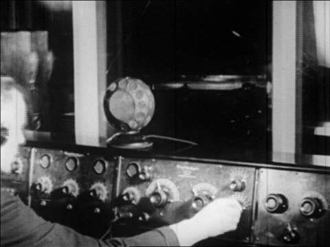 b/w 1920s pan control booth of radio studio in edgewater beach hotel / man's hand in foreground / chicago - microphone stock videos & royalty-free footage