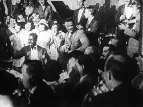 B/W 1920s couples dancing by jazz band in nightclub / Paris, France / documentary