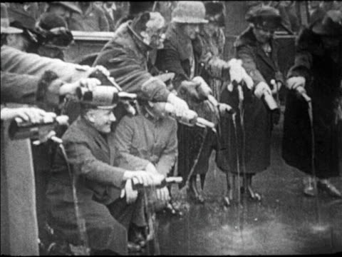 b/w 1920s crowd on street emptying bottles of liquor on city street / new orleans / prohibition - 1920 stock videos & royalty-free footage