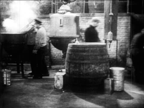 b/w 1920s dolly shot men working in bootleg liquor distillery / prohibition / newsreel - distillery still stock videos and b-roll footage