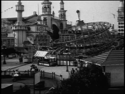 "b/w 1920s fade in ""top"" rotating rides at coney island / nyc / newsreel - fade in stock videos & royalty-free footage"