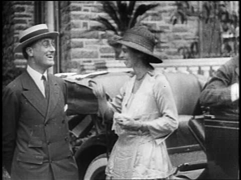 b/w 1920s fd roosevelt in straw hat smiling standing next to eleanor roosevelt / newsreel - straw hat stock videos & royalty-free footage