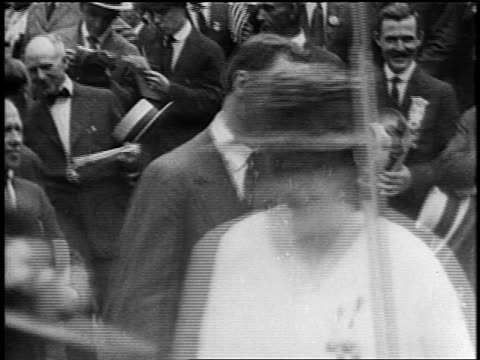 B/W 1920s FD Roosevelt shaking hands smiling with marchers at parade / newsreel