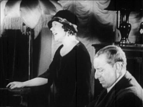 b/w 1920s female opera singer singing next to male piano player - b roll stock videos & royalty-free footage