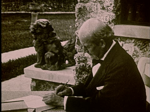 1920s film montage ms william jennings bryan sitting outside while writing/ bryan looking up from his work - william jennings bryan stock videos & royalty-free footage