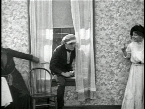 B/W 1920s gangster entering window / man in bathrobe hits him in face with pie / short