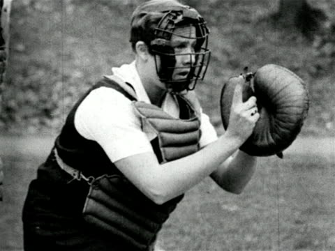 B/W 1920s girl catcher calling pitch in baseball game outdoors / short subject