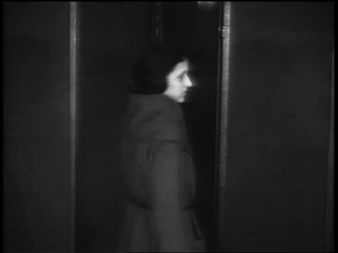 vídeos de stock, filmes e b-roll de b/w 1920s girl modeling coat in vocational school / newsreel - only teenage girls