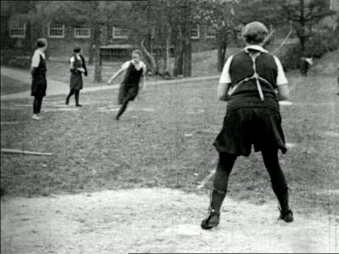 B/W 1920s girls running to home plate in girls' baseball game outdoors / short subject