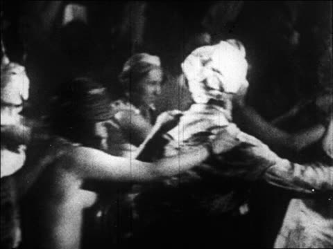 b/w 1920s group of people in costumes dancing in conga line / paris, france / documentary - 1920 stock videos & royalty-free footage
