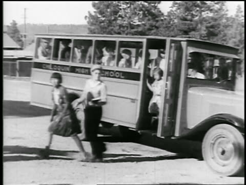 b/w 1920s group of young native american schoolchildren getting off school bus / educational - indigenous peoples of the americas stock videos & royalty-free footage
