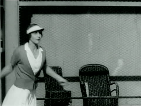 b/w 1920s helen wills playing at tennis in tournament / documentary - gara sportiva individuale video stock e b–roll