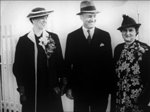 vídeos de stock e filmes b-roll de b/w 1920s henry morganthau jr wife elinor standing with eleanor roosevelt laughing / newsreel - primeira dama