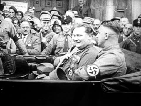 b/w 1920s hermann goering 2 other men riding in convertible / 1 man raises arm in salute / germany - hermann goering stock videos & royalty-free footage