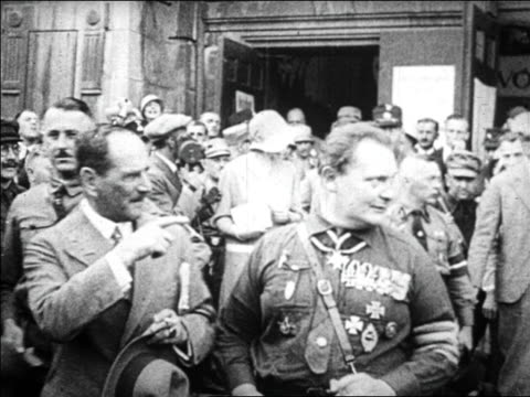 b/w 1920s hermann goering other man pointing looking offscreen / crowd in background / germany - hermann goering stock videos & royalty-free footage